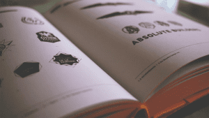 setting a budget - logo inspiration in a book