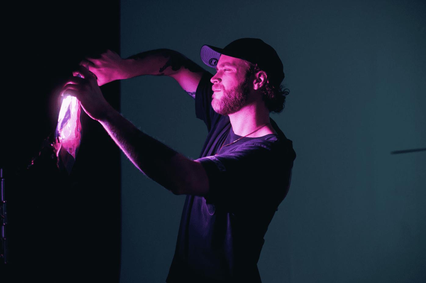 man creating visual content