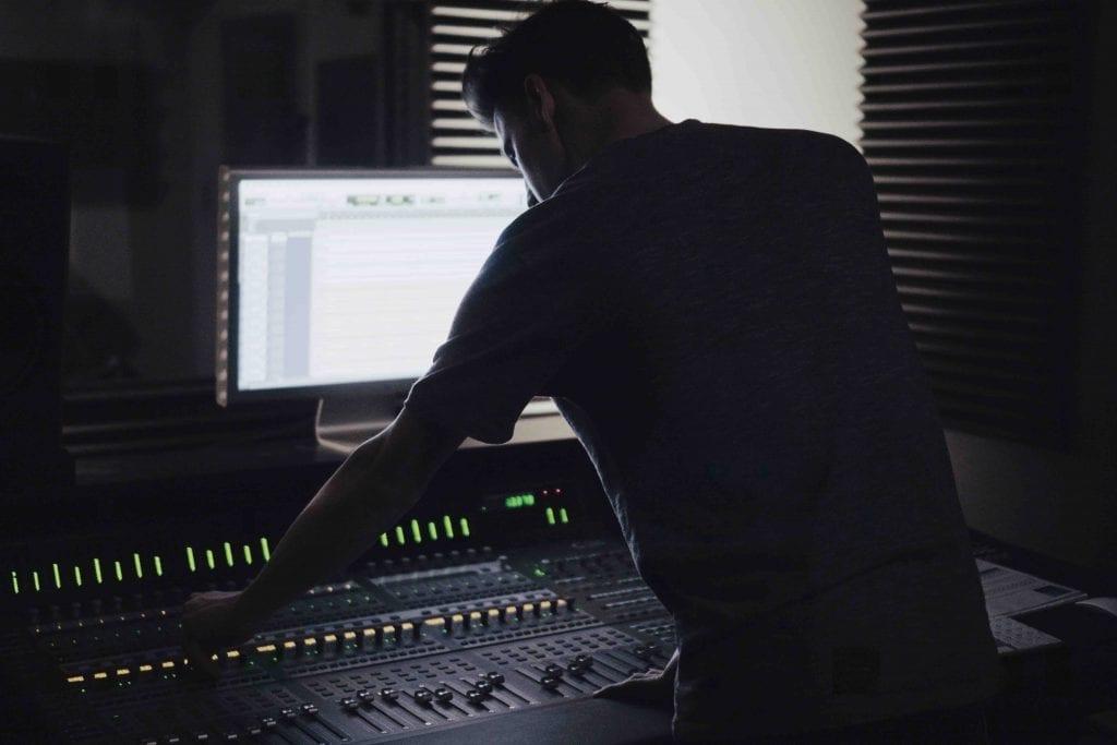 Musician in studio editing royalty free music
