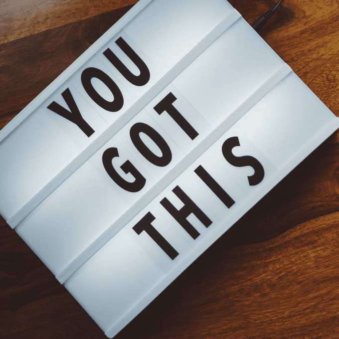 "Illuminated text block with the words ""you got this"" featured on wooden table"
