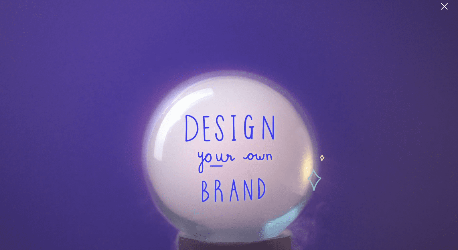 crystal ball with words 'design your own brand' seen on top of purple backdrop