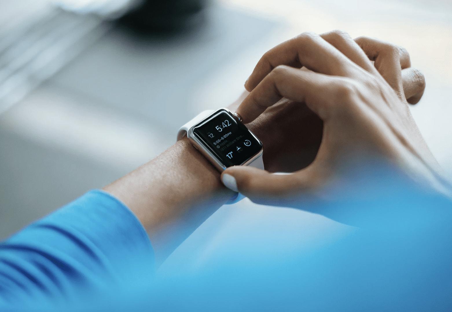woman wearing high-tech watch, changing its time