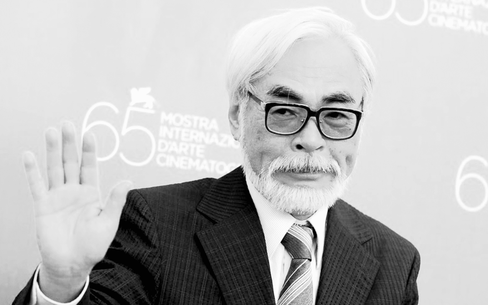 portrait of Hayao Miyazaki waving at camera
