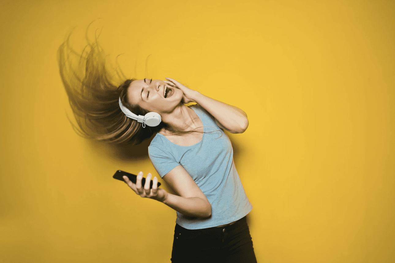 woman listening to music and enjoying herself