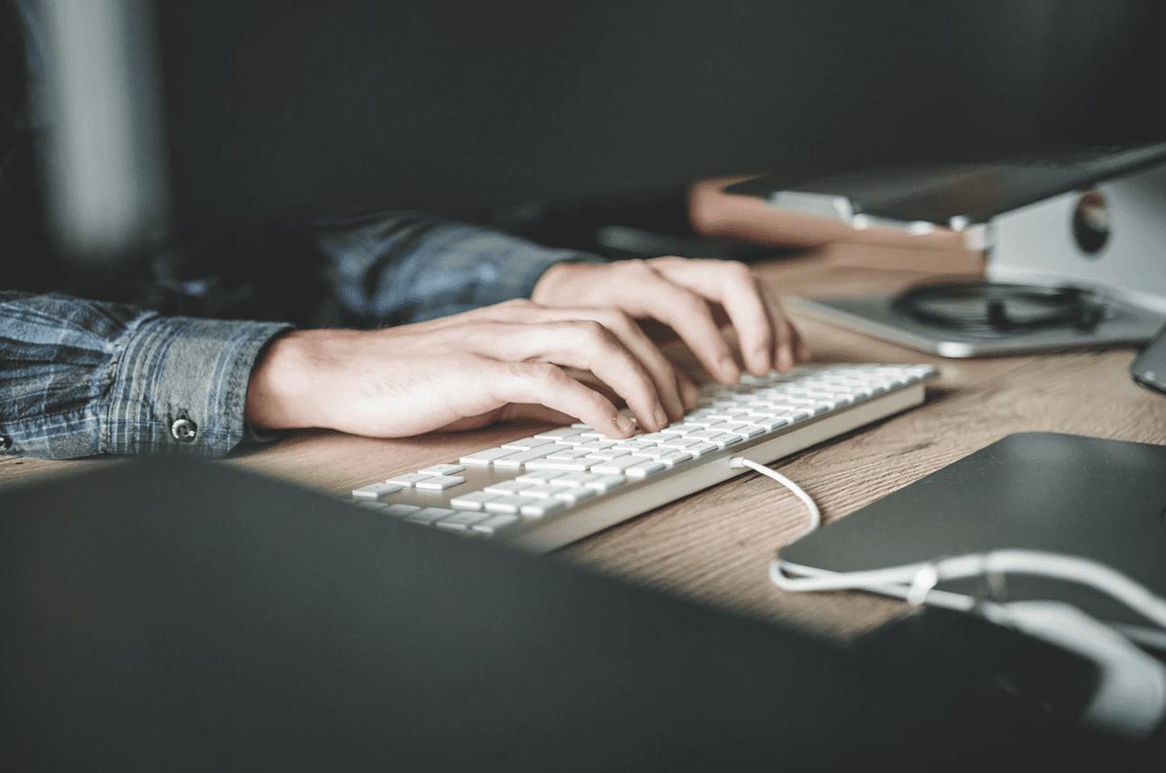 freelancer using software typing on keyboard