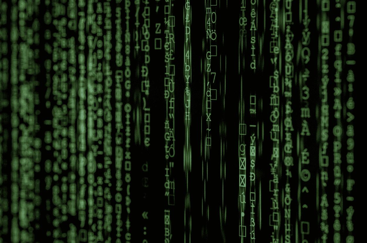 matrix movie still hacker binary code on computer screen