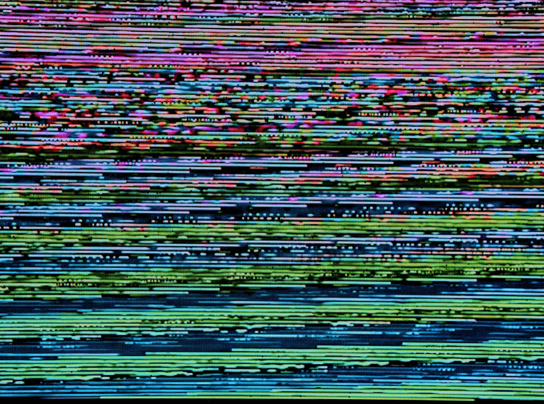 computer screen with pixelated colours on it