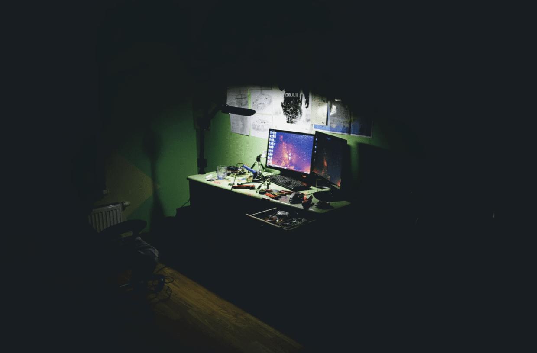 computer screen in dark corner