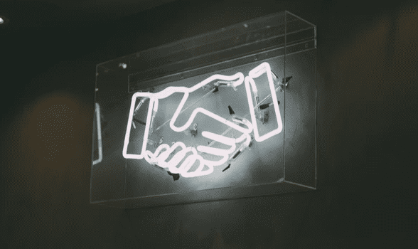 electric light of shaking hands