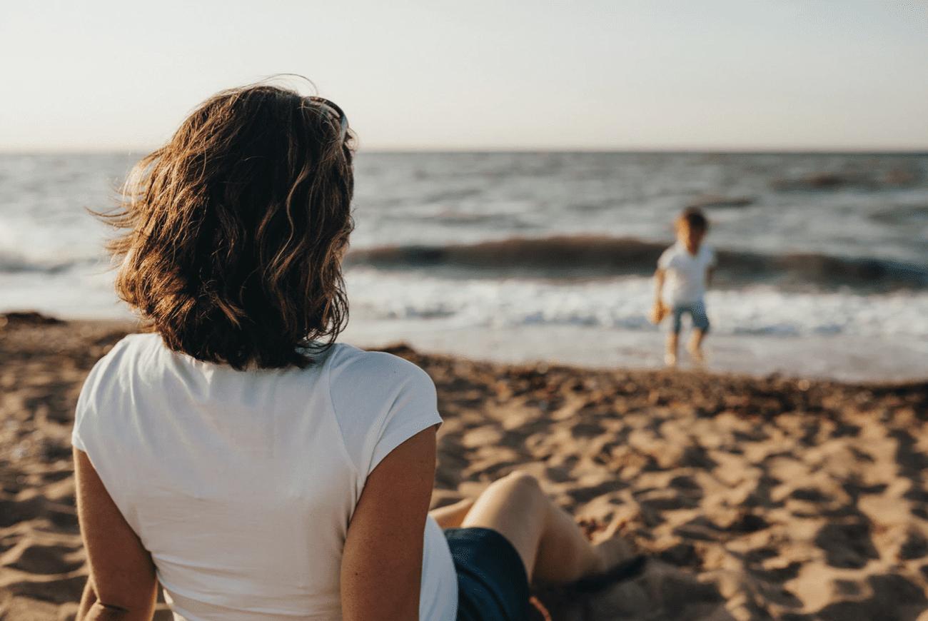 woman sat at the beach