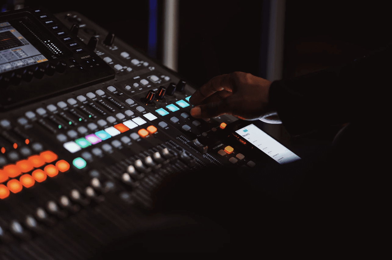 a music producer using a mixing deck to created bit crushed music
