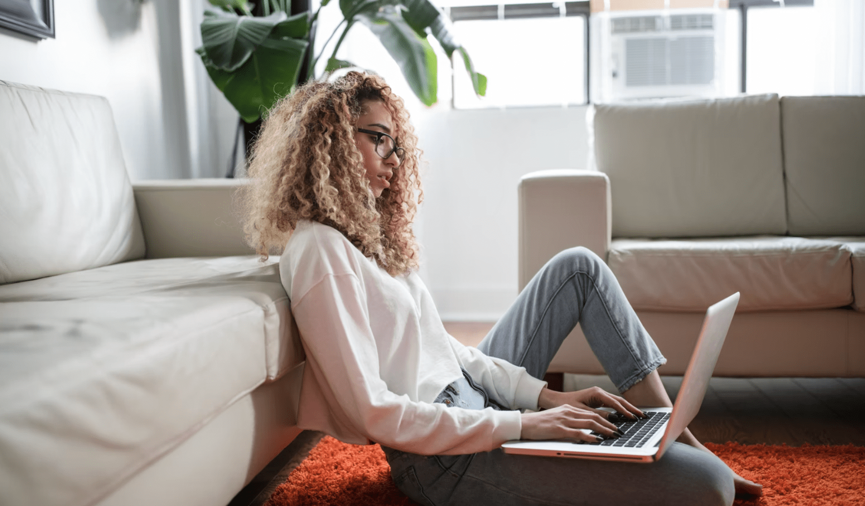 freelancer creating an email marketing strategy on laptop