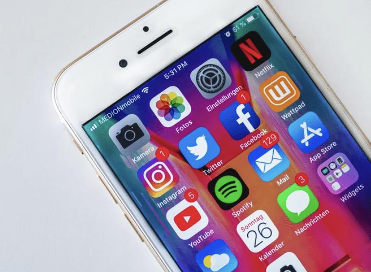 close up of iphone showing social media app widgets